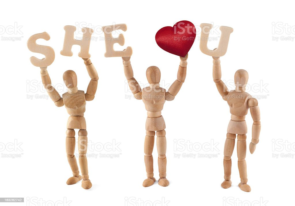 She loves you - wooden mannequin holding words and heart royalty-free stock photo