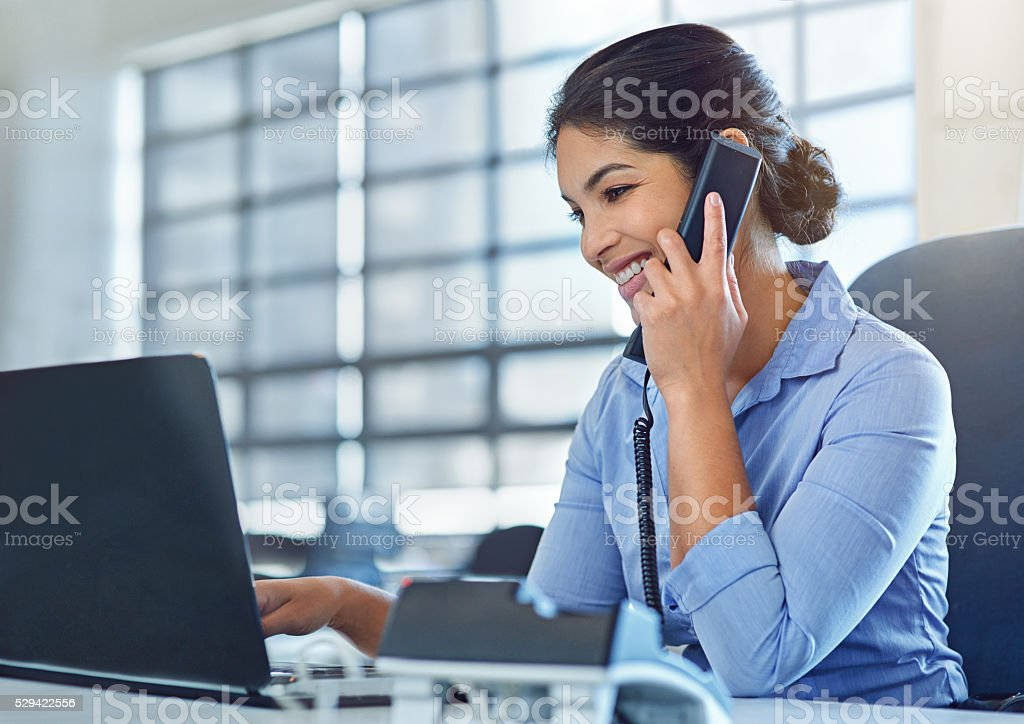 She makes multitasking look like a breeze stock photo