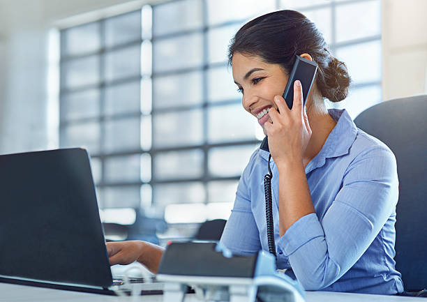 she makes multitasking look like a breeze - receptionist stock photos and pictures
