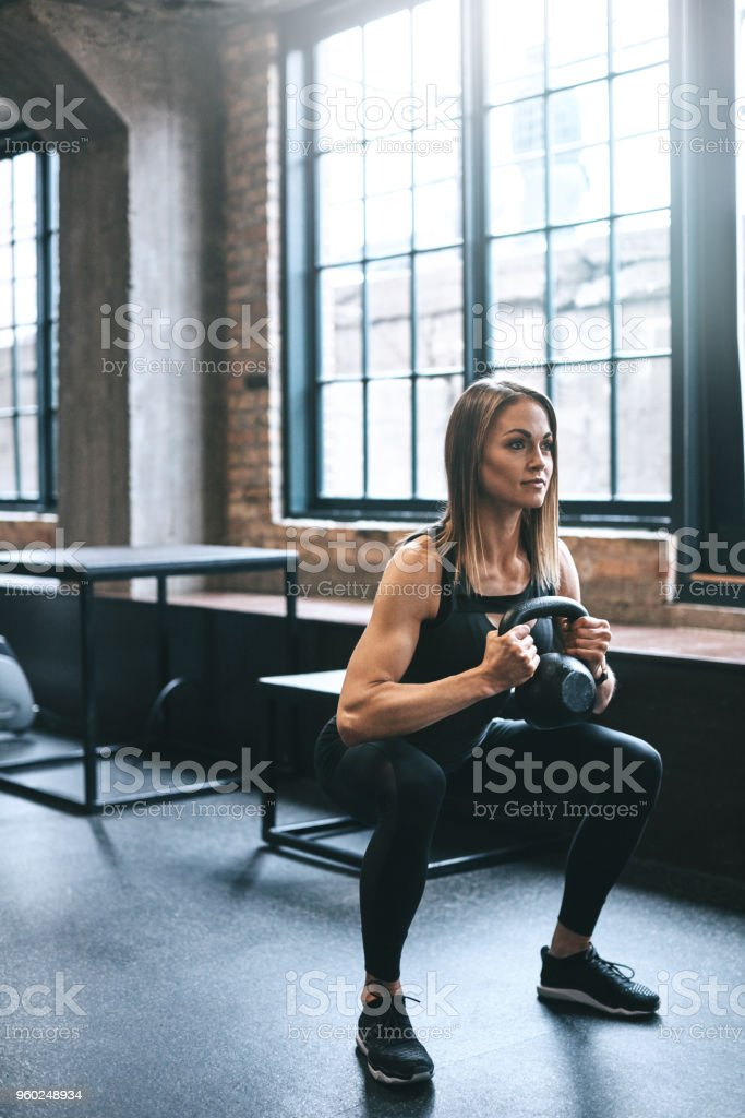 She never skips out on leg day stock photo