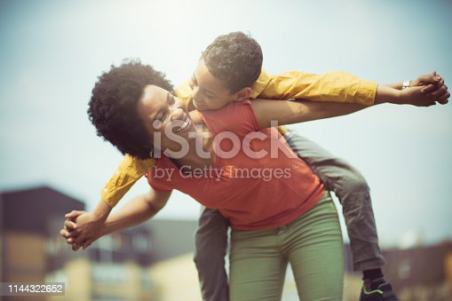 1091098026istockphoto She one fun mom. 1144322652