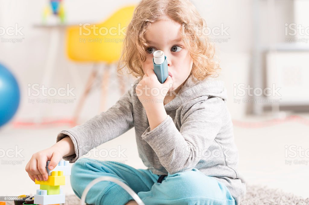 She prefers to play rather than taking her medicine stock photo