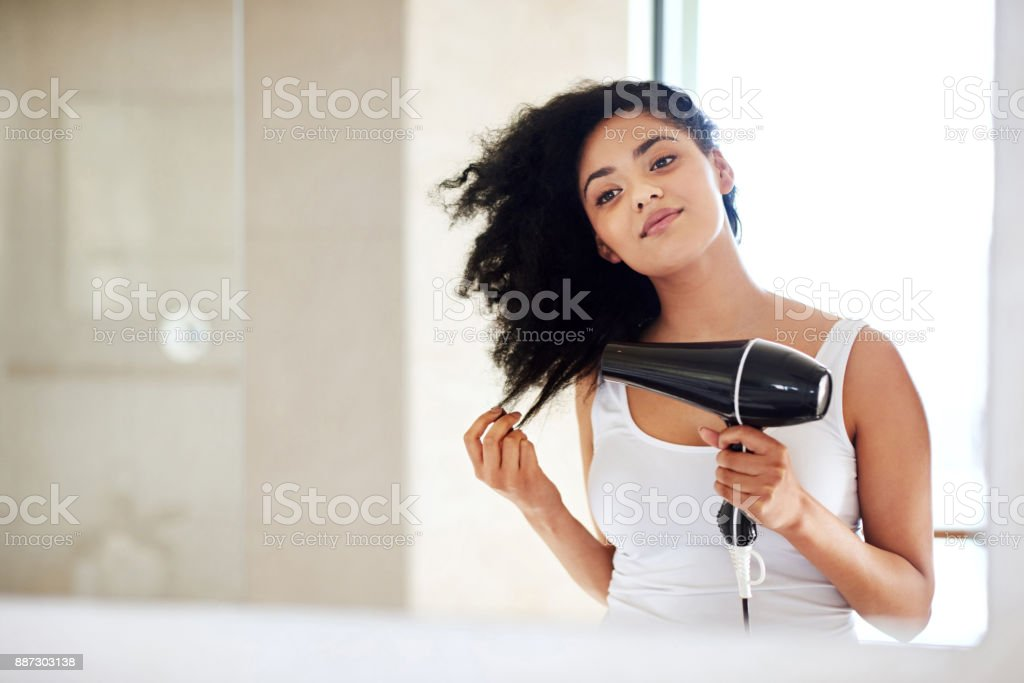 She puts a lot of love into her hair stock photo