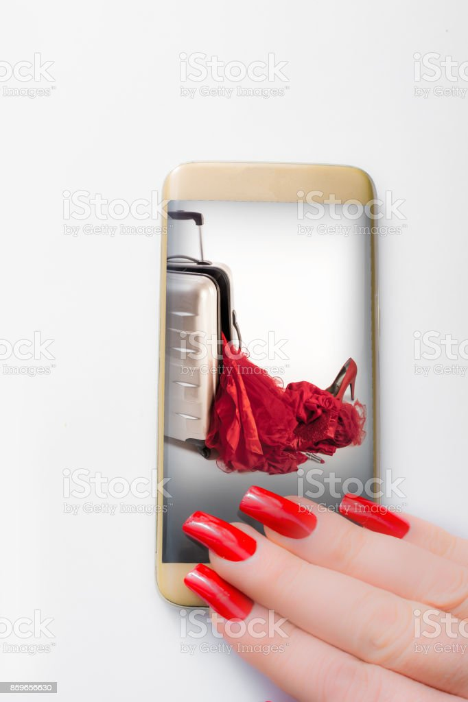 She receives a picture what happend to her spinner suitcase on her phone stock photo