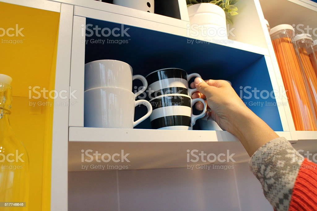 She straightened the kitchen . stock photo