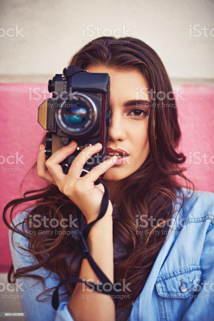 She takes her camera everywhere to capture memories zbiór zdjęć royalty-free