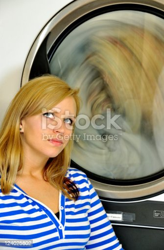 istock She Waits as the Dryer Goes 'Round and Around 124025802