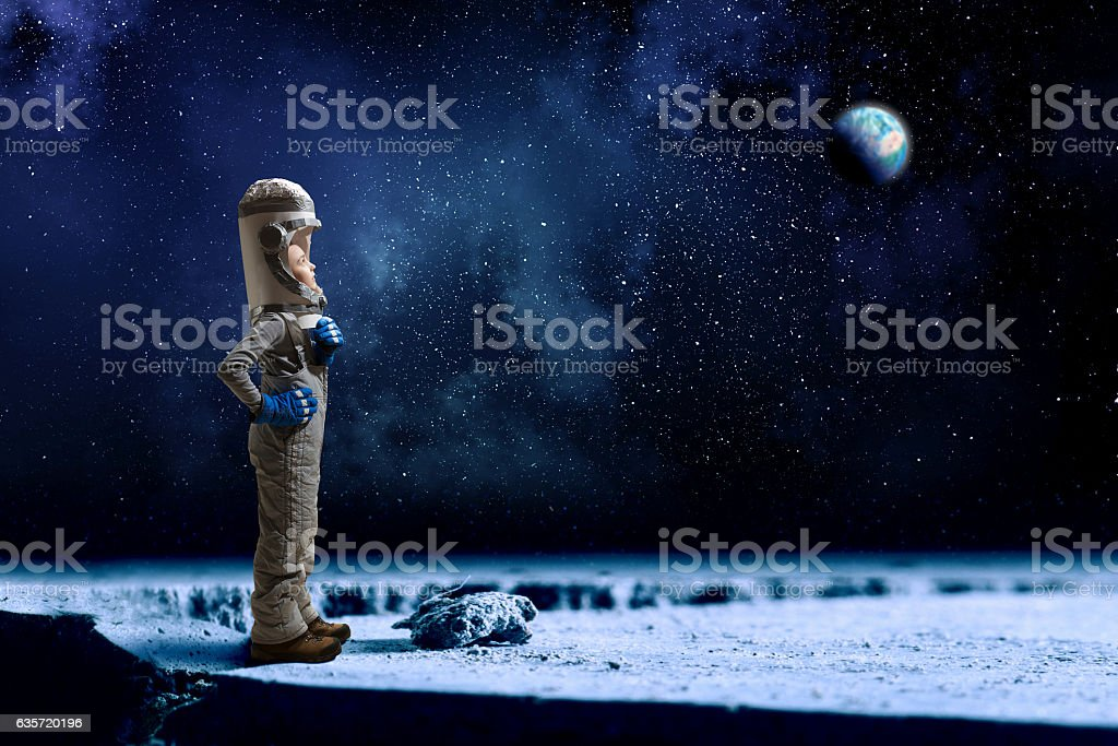 She wants to become astronaut . Mixed media stock photo