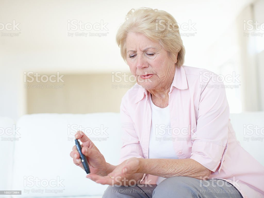 She was feeling a bit faint - Diabetes royalty-free stock photo