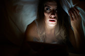 istock She watching scary movie being alone at home 535240905