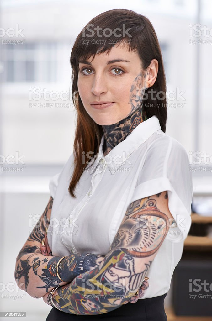 She wears her art on her sleeve stock photo