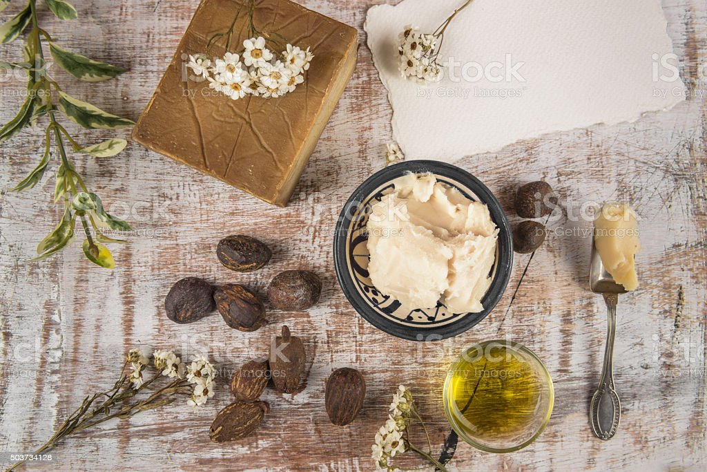 Shea butter with shea product and nuts stock photo