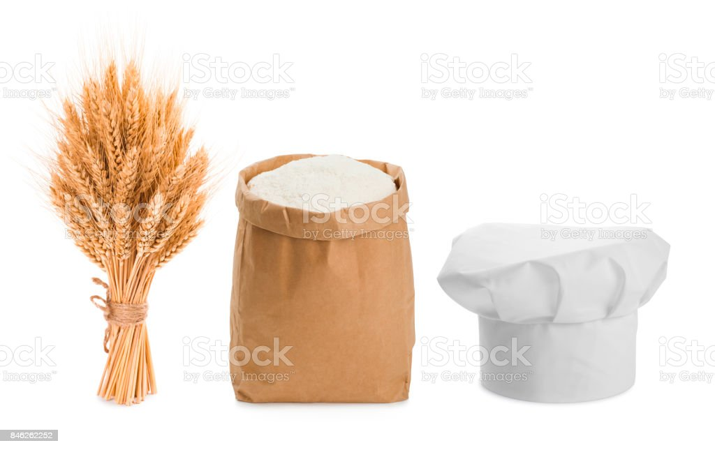 Sheaf of wheat, chefs hat and flour isolated on white stock photo