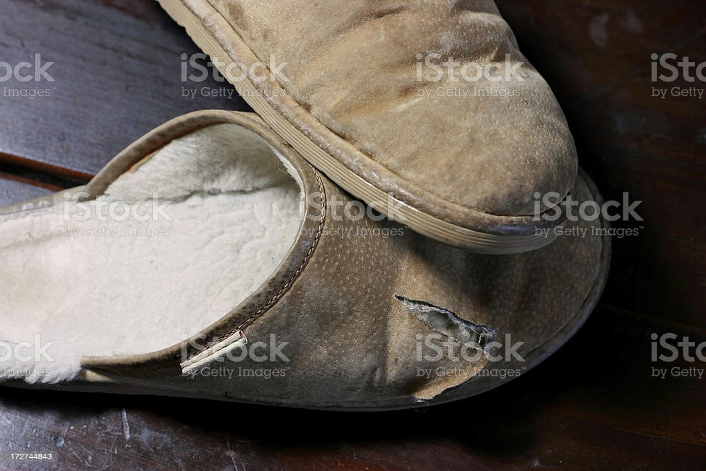 shearling slippers on dark wood background still life stock photo