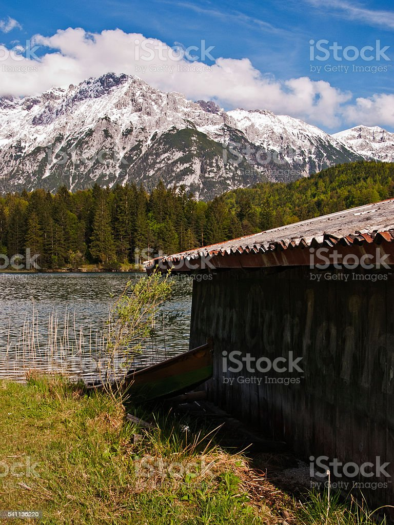 Shed and boat at lake in Karwendel mountain range stock photo