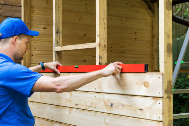 shed construction - worker check the level of wooden plank wall shed construction - worker check the level of wooden plank wall shed stock pictures, royalty-free photos & images