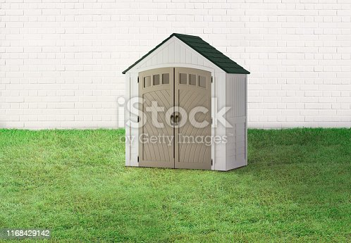 Shed in a backyard with brick wall and grass