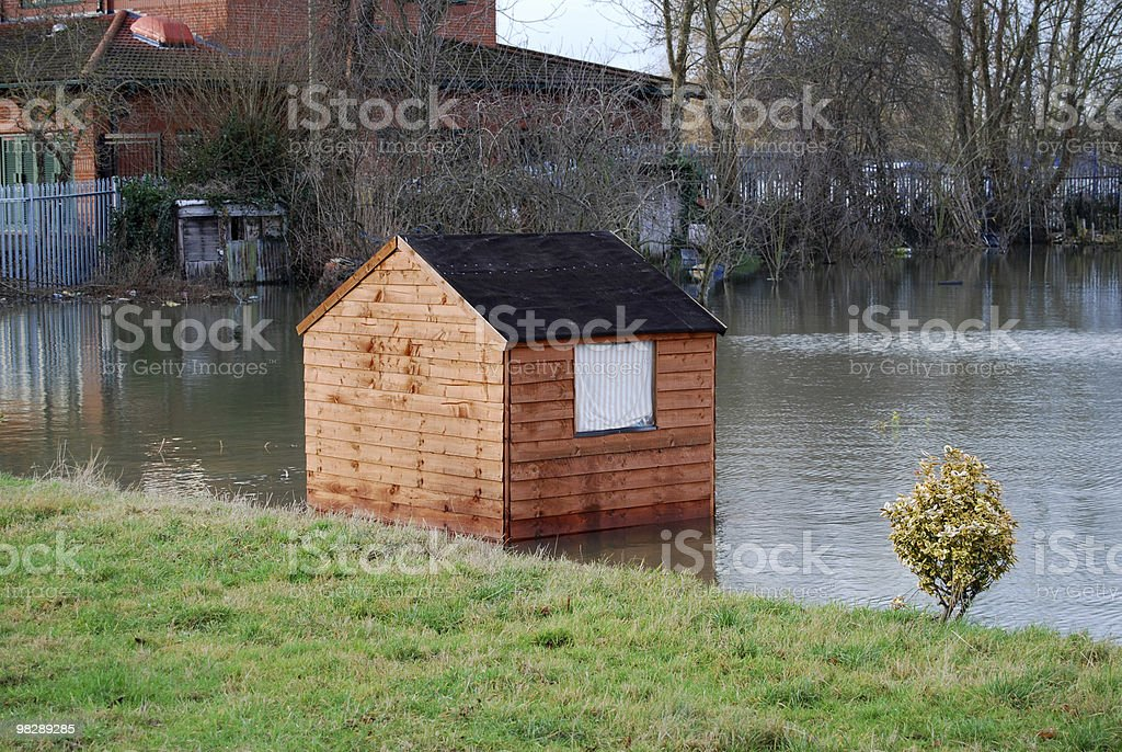 Shed in flooded field. Oxford, England royalty-free stock photo