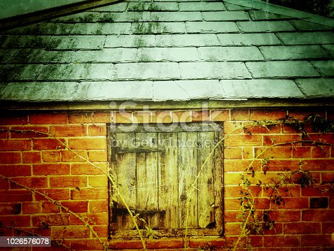Brick shed wooden window