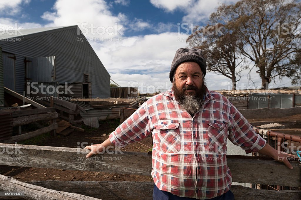 Sheep Farmer standing near a Shed stock photo