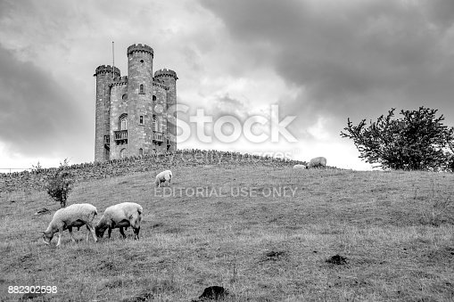 Sheep grazing below the historic Broadway Tower, which sits high on the Cotswold escapment at 1024 feet (312m) above sea level. The second highest after Cleeve Hill at 1,083 feet (330 m). Long exposure giving movement in the clouds