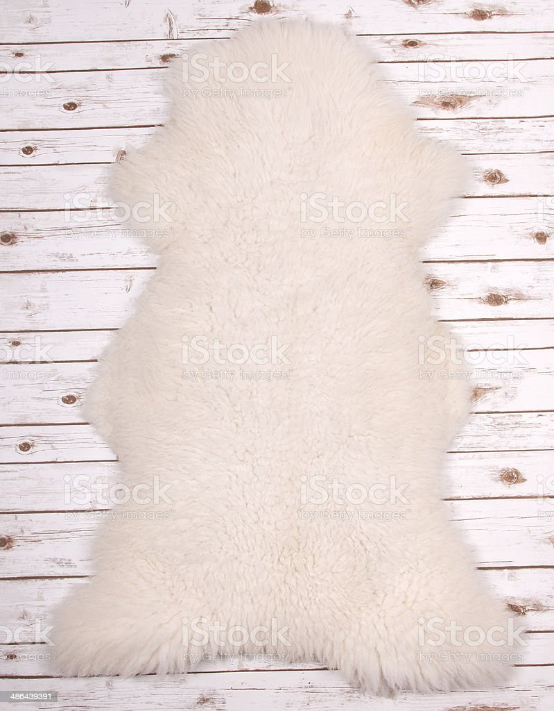 A Sheep Skin on a wooden floor