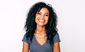 istock Sheer beauty. Front portrait of attractive African American woman with fuzzy jet-black hair and almond-shaped eyes, looking at the camera and smiling broadly. 1180642153