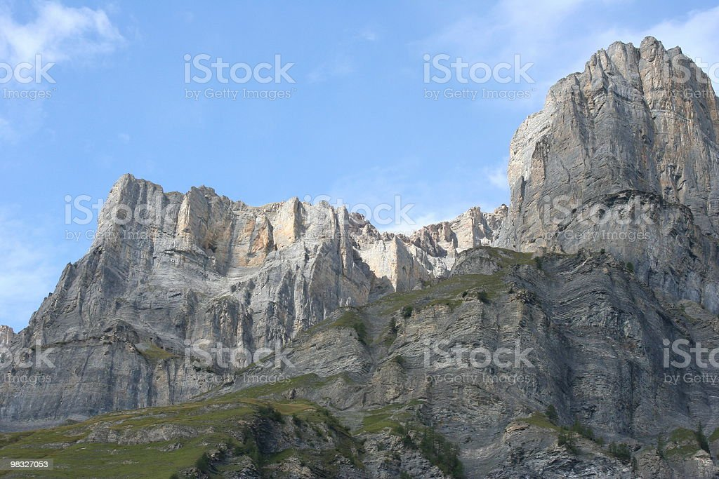 Sheer rock faces in mountains stock photo