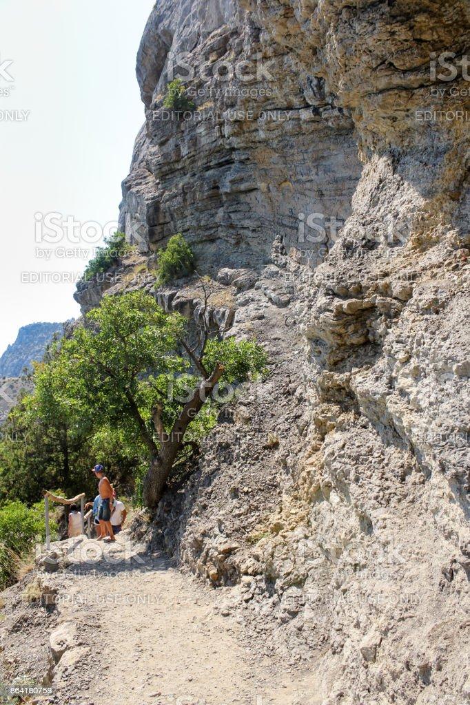 Sheer stone walls along the path. royalty-free stock photo