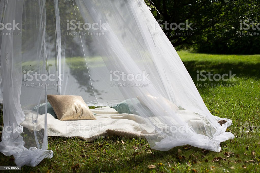 Sheer tent in the garden stock photo