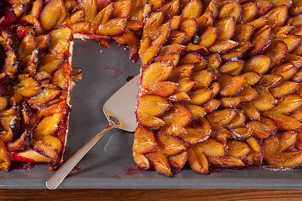sheet cake, plum cake, piece, cake shovel - pflaumentarte stock-fotos und bilder