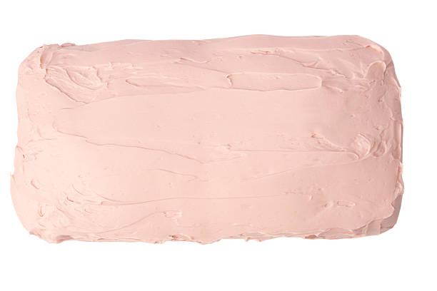 cheese cake avec glaçage rose - glaçage photos et images de collection