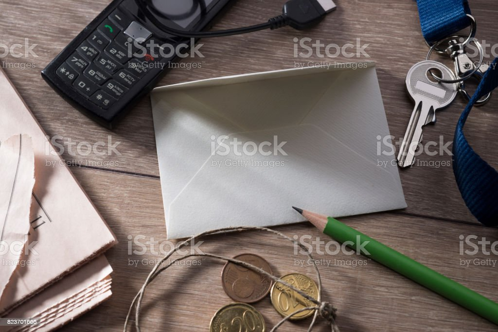 A sheet for writing on a table surrounded by objects of daily use. stock photo