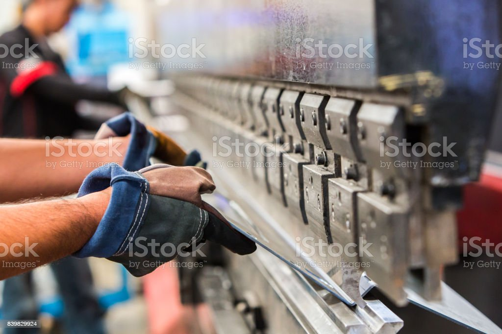Sheet metal bending in factory stock photo