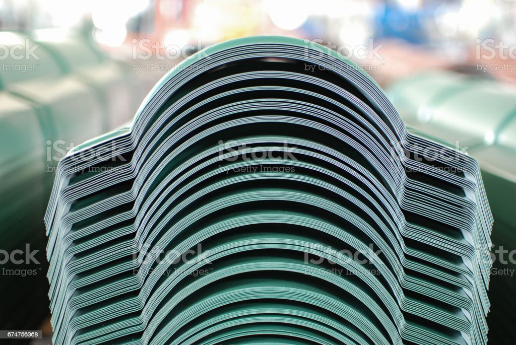 Sheet metal flashings stacked on a pile stock photo