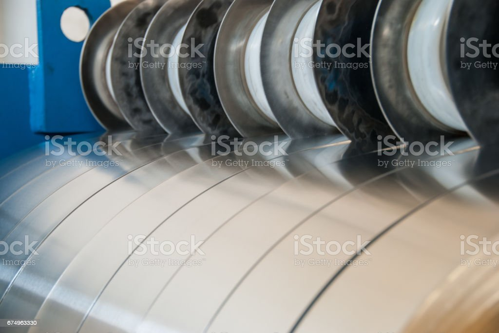Sheet metal strips exiting the slitting line stock photo