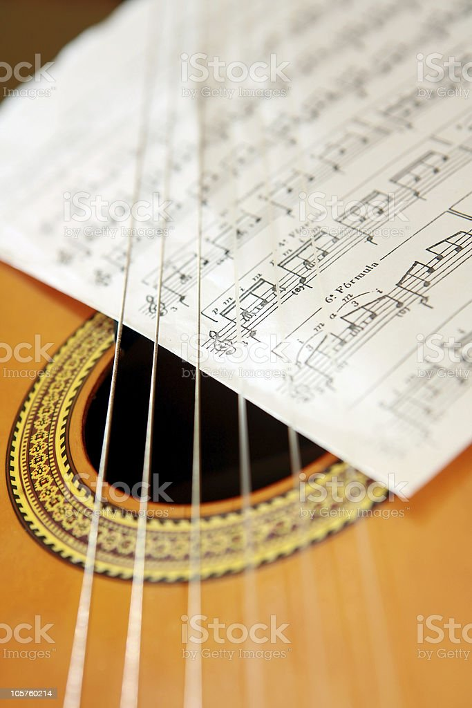 sheet music and guitar royalty-free stock photo