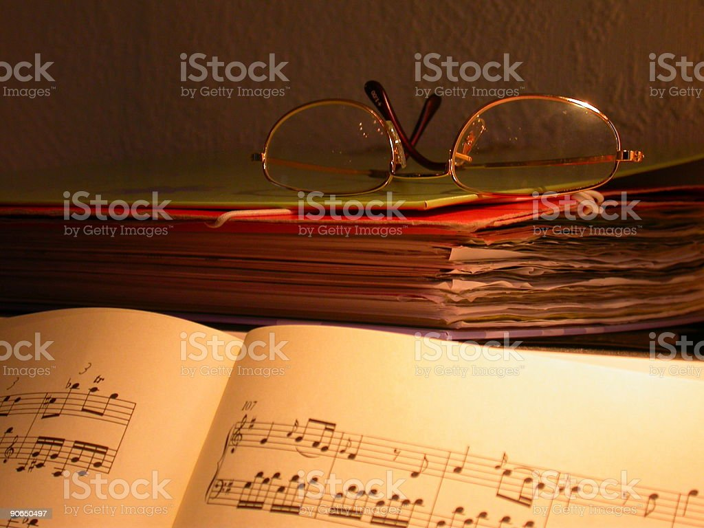 Sheet music and reading glasses on a piano stock photo