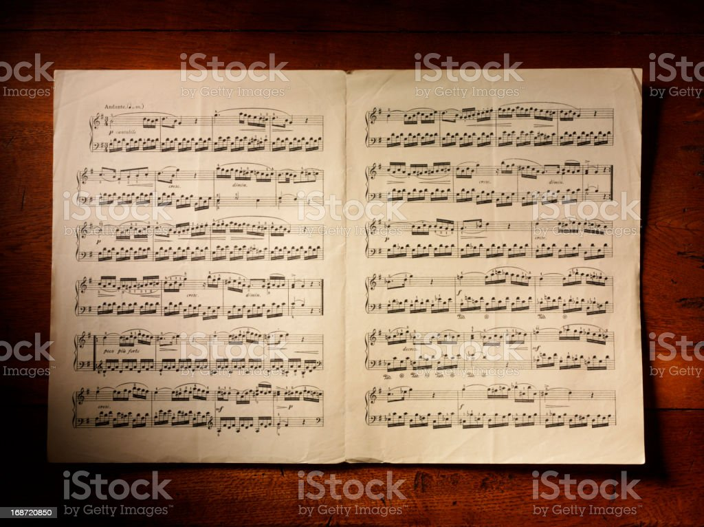 Sheet Music and Rustic Table stock photo