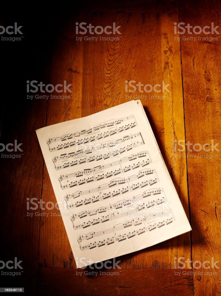 Sheet Music on a Oak Table stock photo
