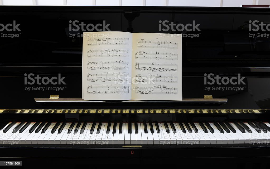 sheet music on black lacquered piano XXXL image stock photo