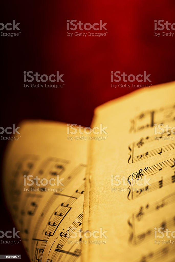 Sheet music on red velvet royalty-free stock photo