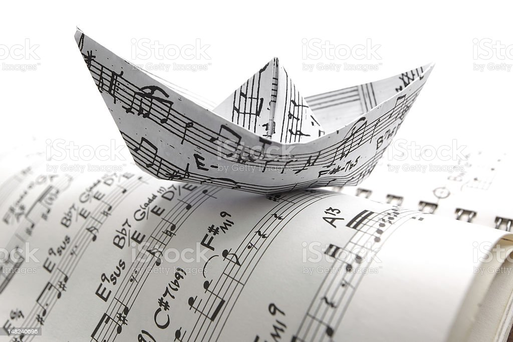 Sheet music paper boat stock photo