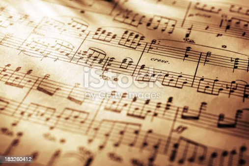 Close-up shot of sheet music in sepia tone.Similar images -