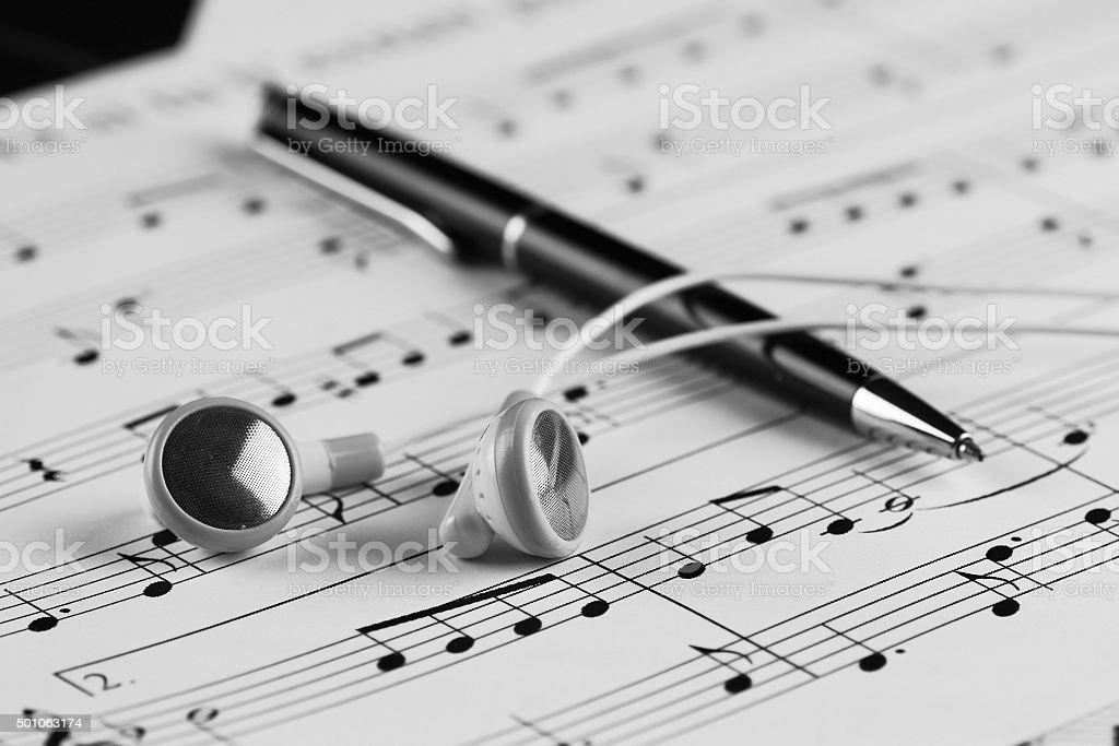 Sheet music with a number of accessories stock photo