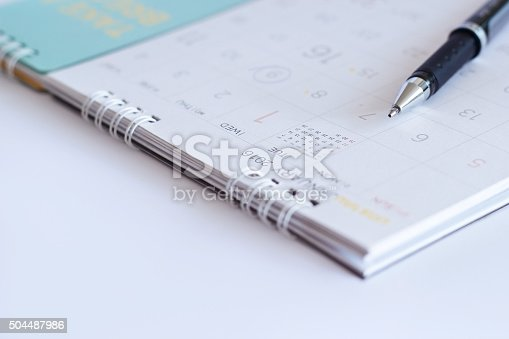 177774403 istock photo sheet of a calendar and a pen on white background 504487986