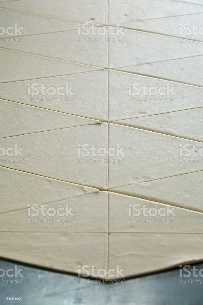 Sheet of Cut Croissant Dough stock photo