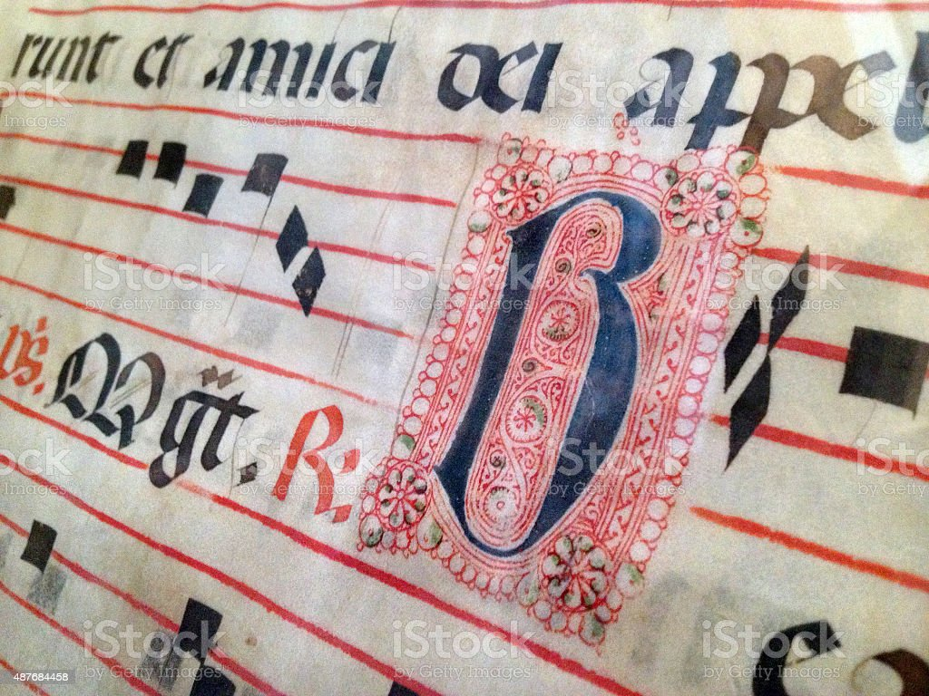 Sheet of medieval musical manuscript close-up stock photo