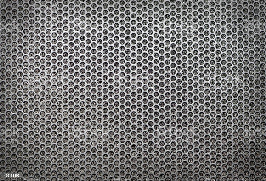 Sheet of metal covered circular holes stock photo