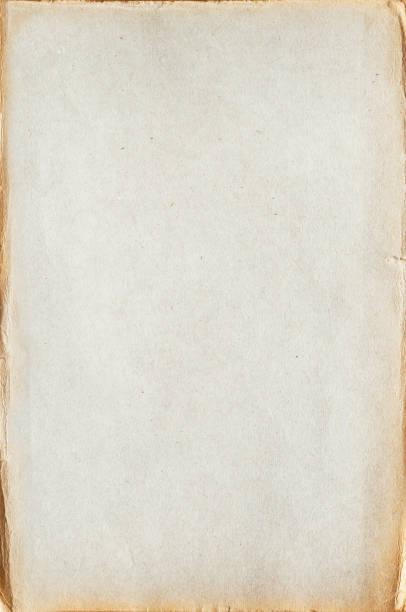 sheet of old blank yellowed paper with crumpled edges - paper texture stock photo
